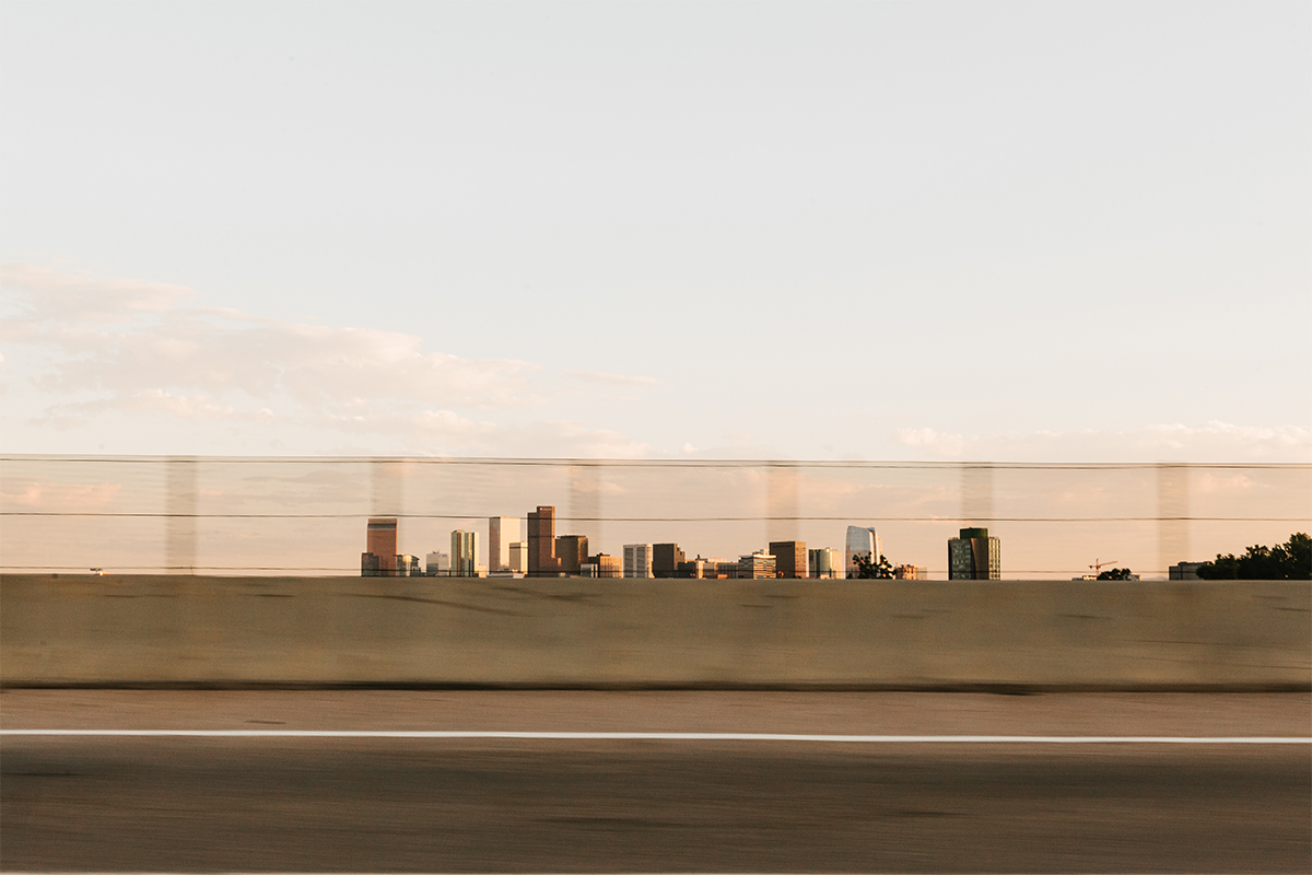 Blurry photo of Denver skyline taken from moving car