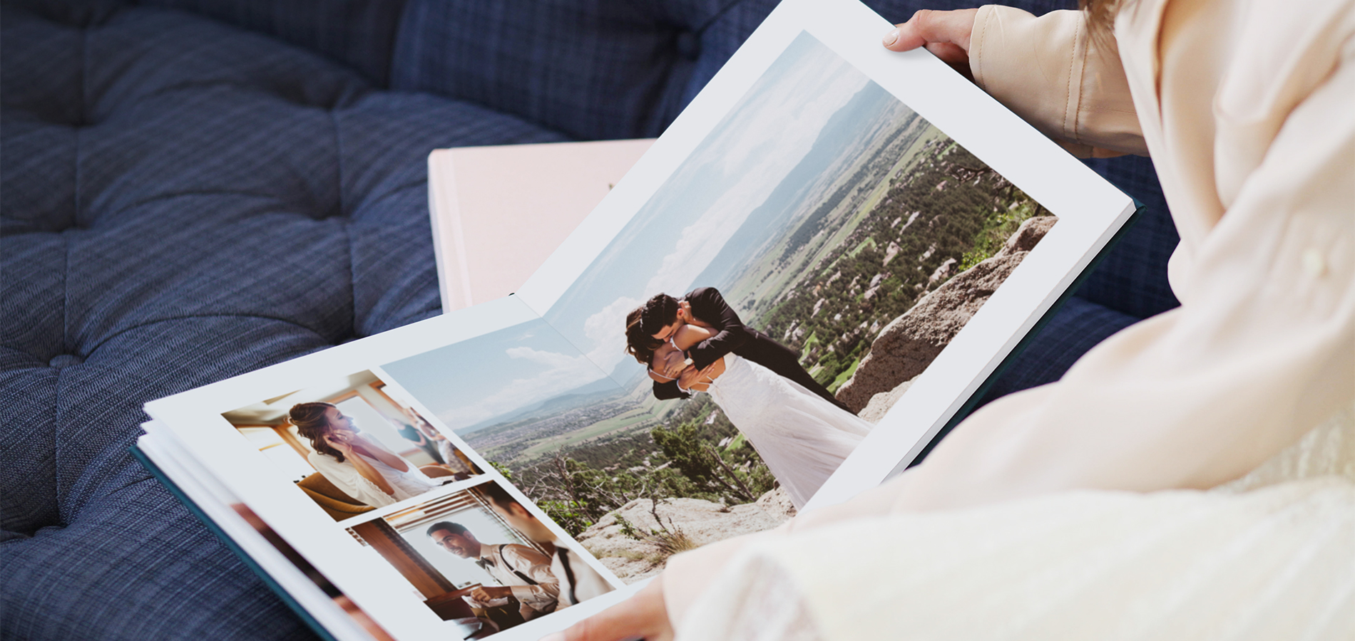 hands holding opened wedding album full of photo book layout ideas