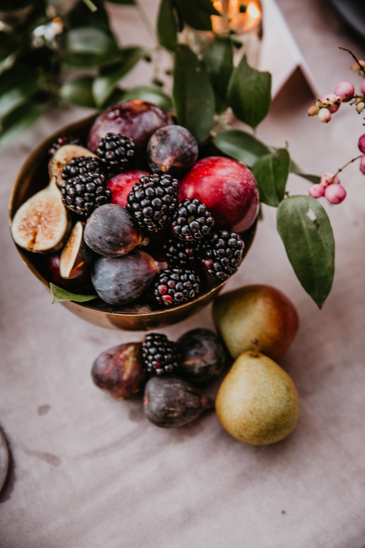 Artistic photo of brass bowl of fruit