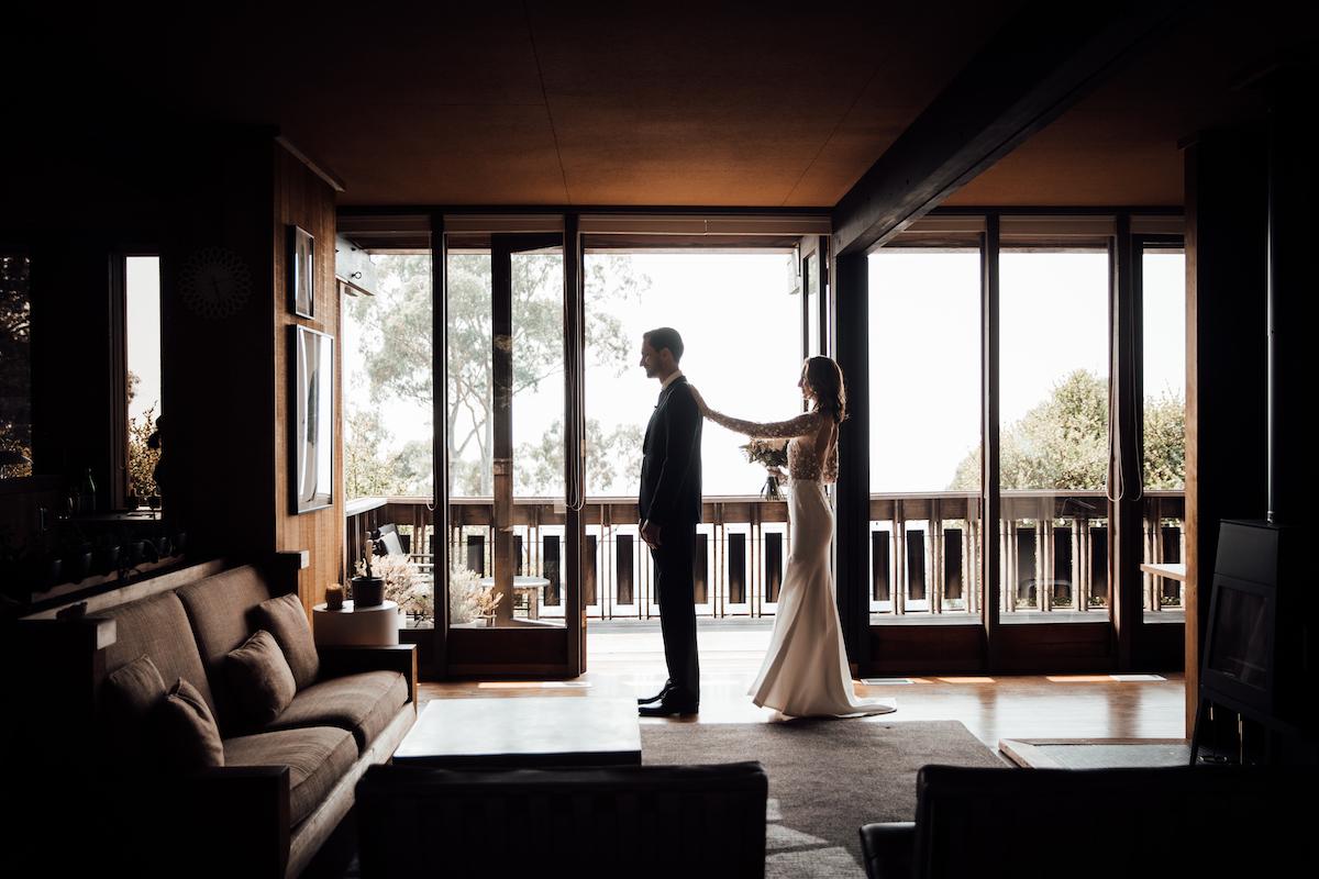 Bride helping groom get ready