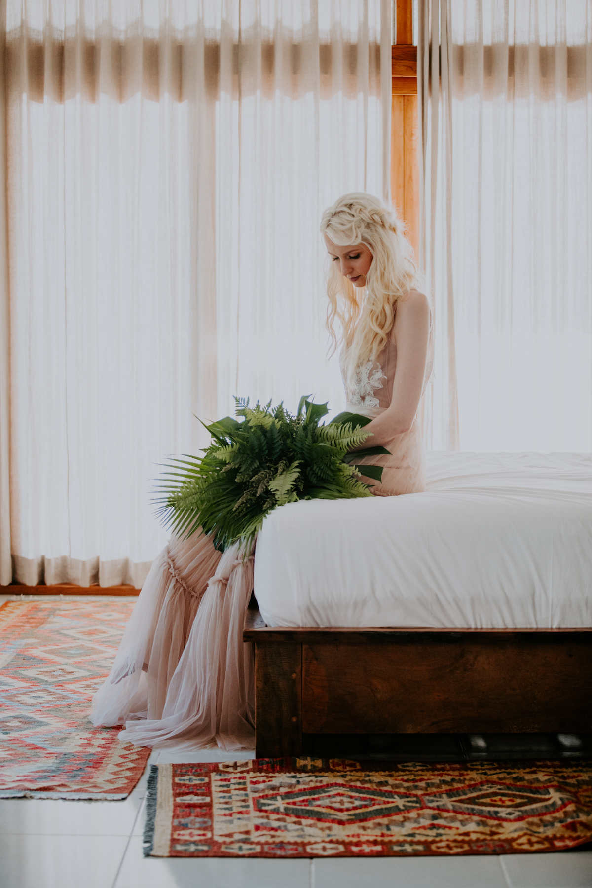 Bride sitting on bed in contemplation