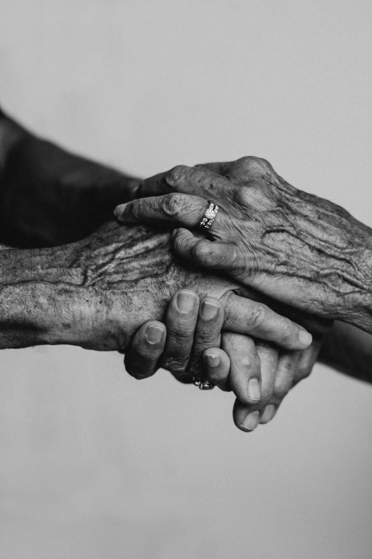 Close up shot old hands holding young hands