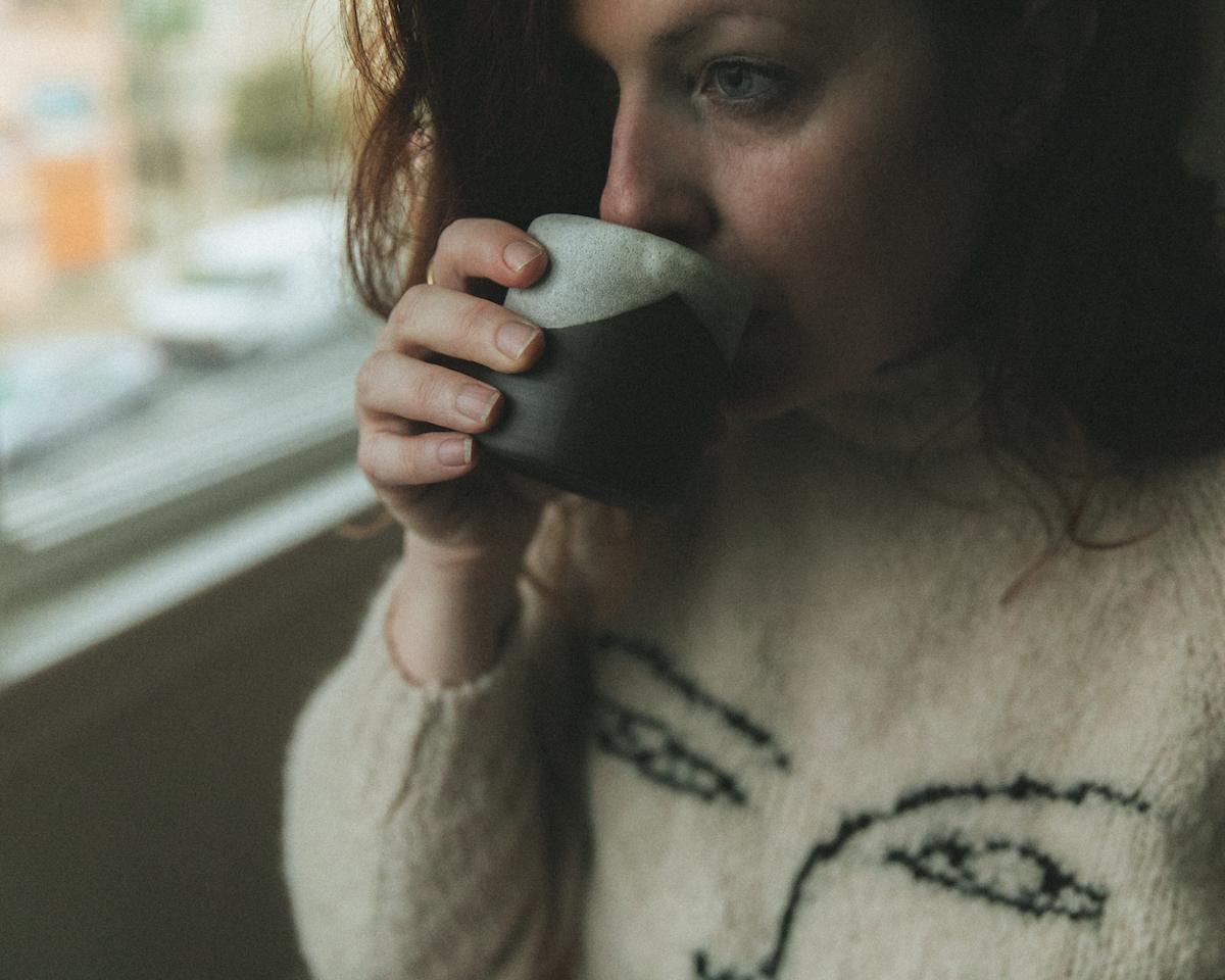 Self-portrait of Ashley Kelemen sipping coffee