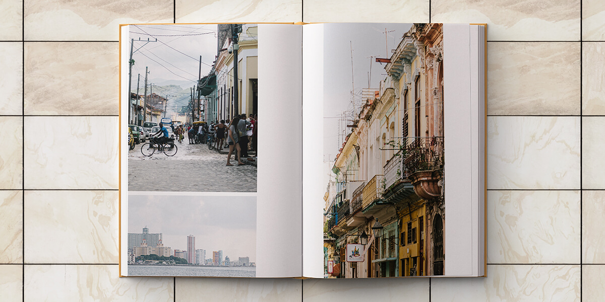 Cuba photo album opened to two-pages of cityscape images