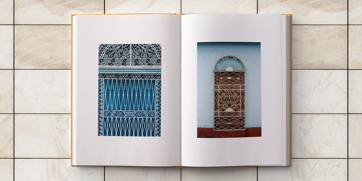 Cuba photo album opened to photos of Cuban architectural elements