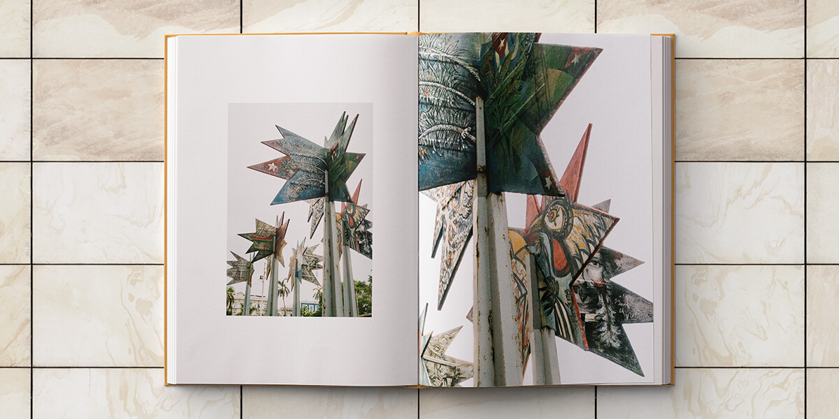 Cuba photo album opened to two pages of similar images grouped together