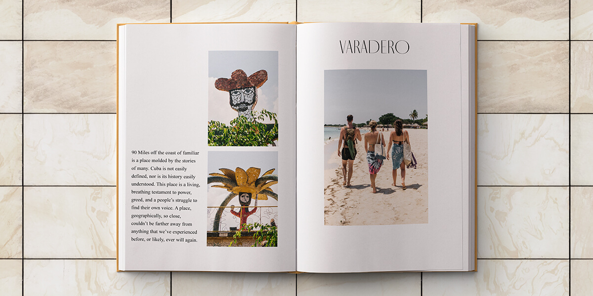 Cuba photo album opened to interior pages with text next to images