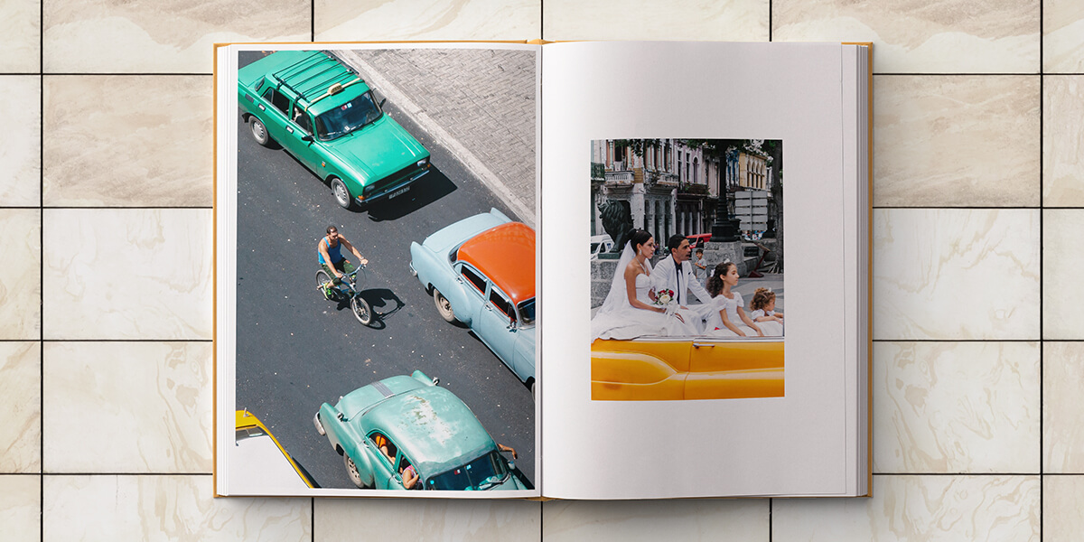 Cuba album opened up to image of family riding in classic convertible