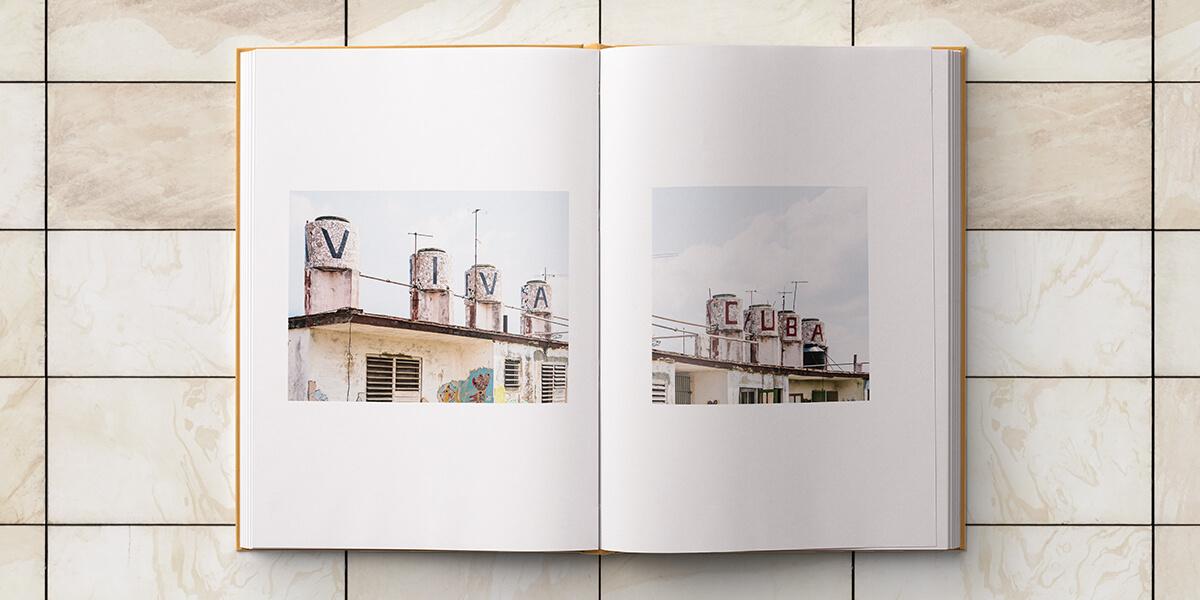 Cuba photo album opened up to panoramic photo split into two photos