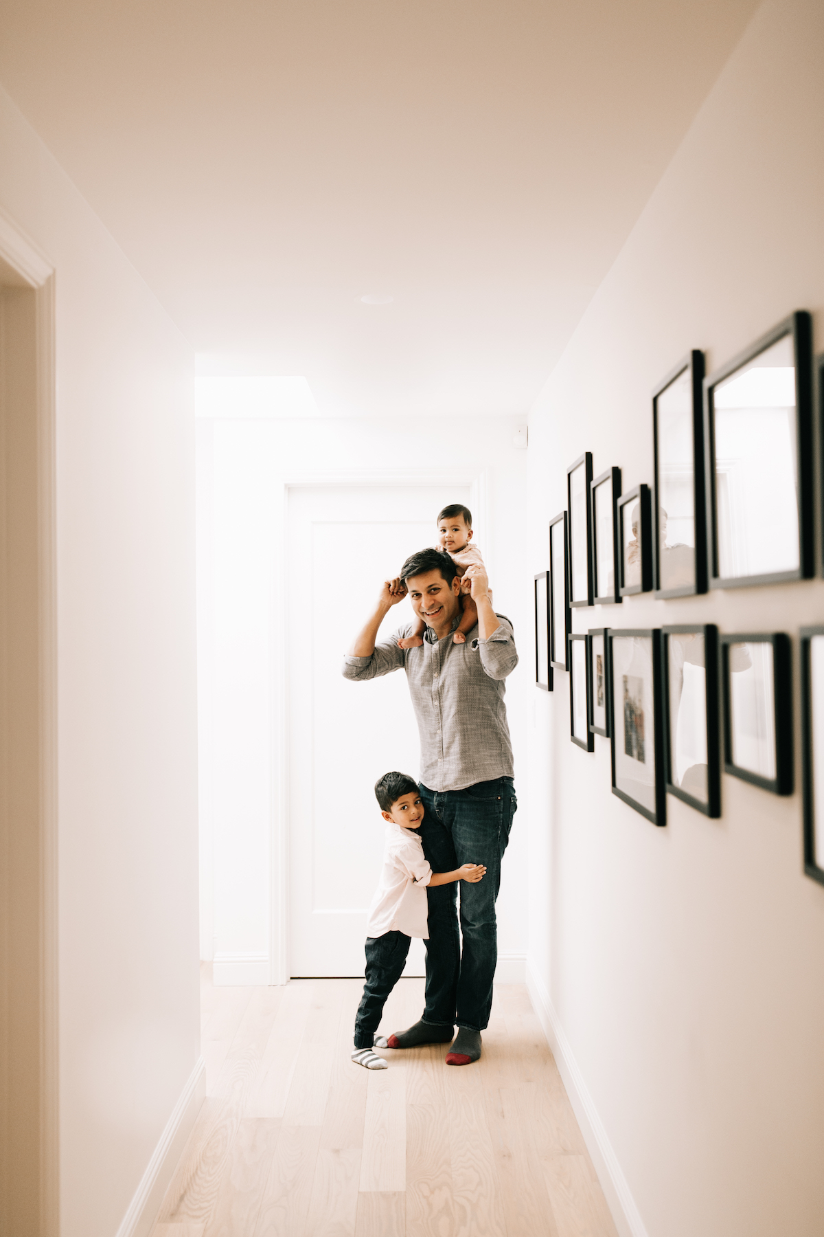 Father with children in brightly lit hallway