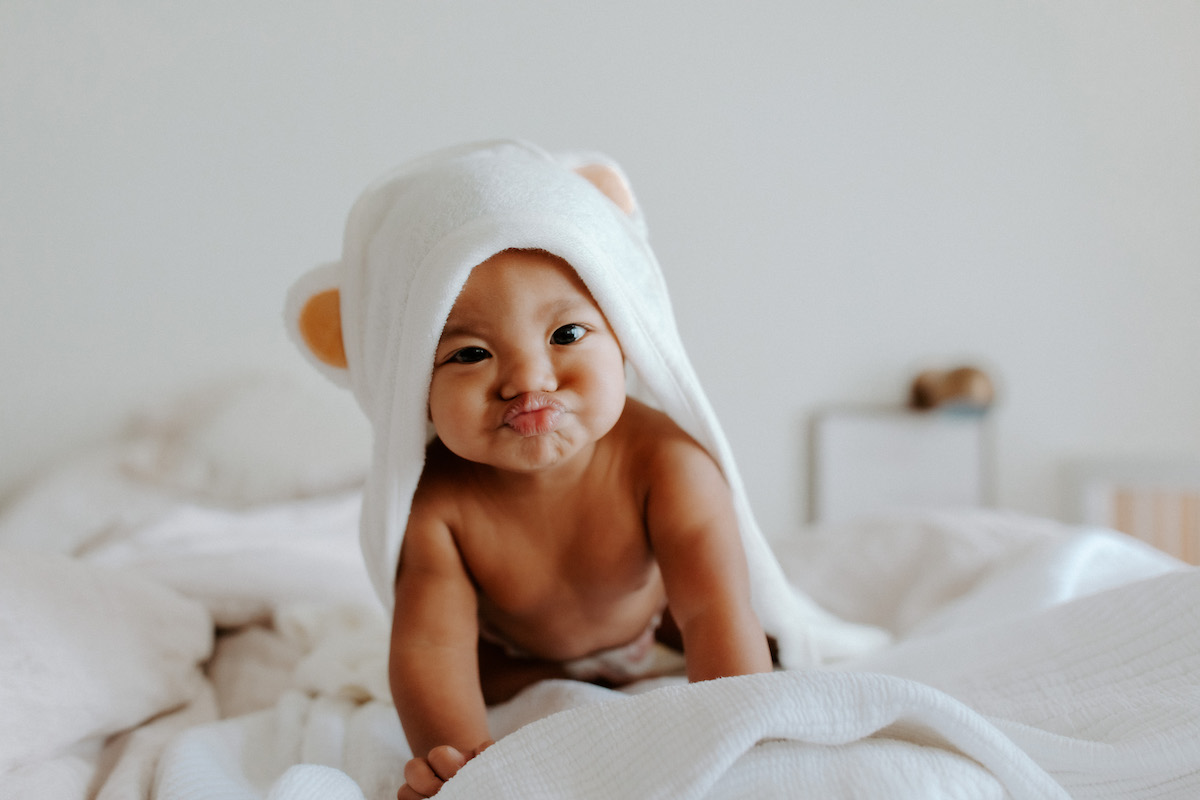 Baby crawling on bed after bath time