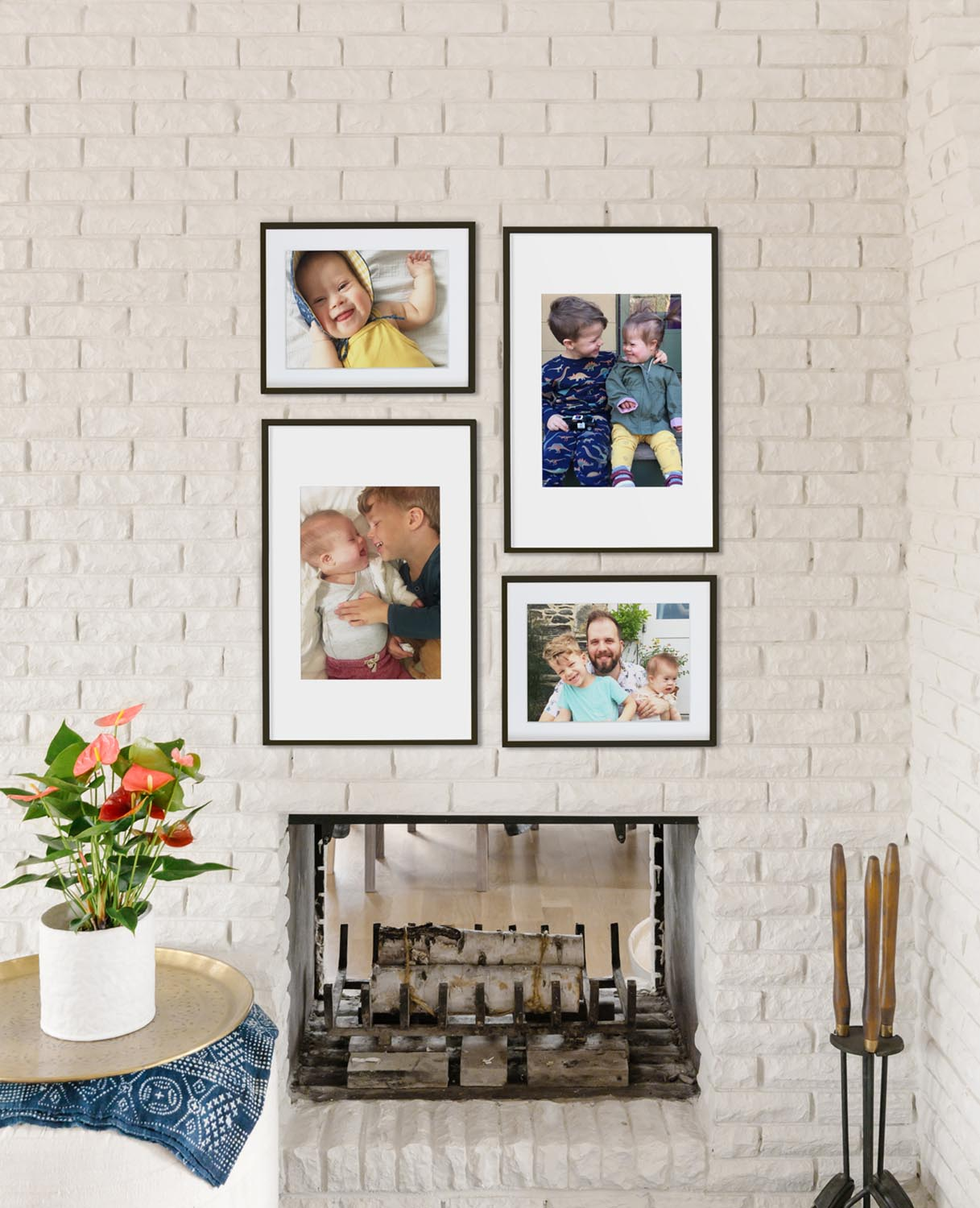 Two-column gallery wall with frames in alternating sizes