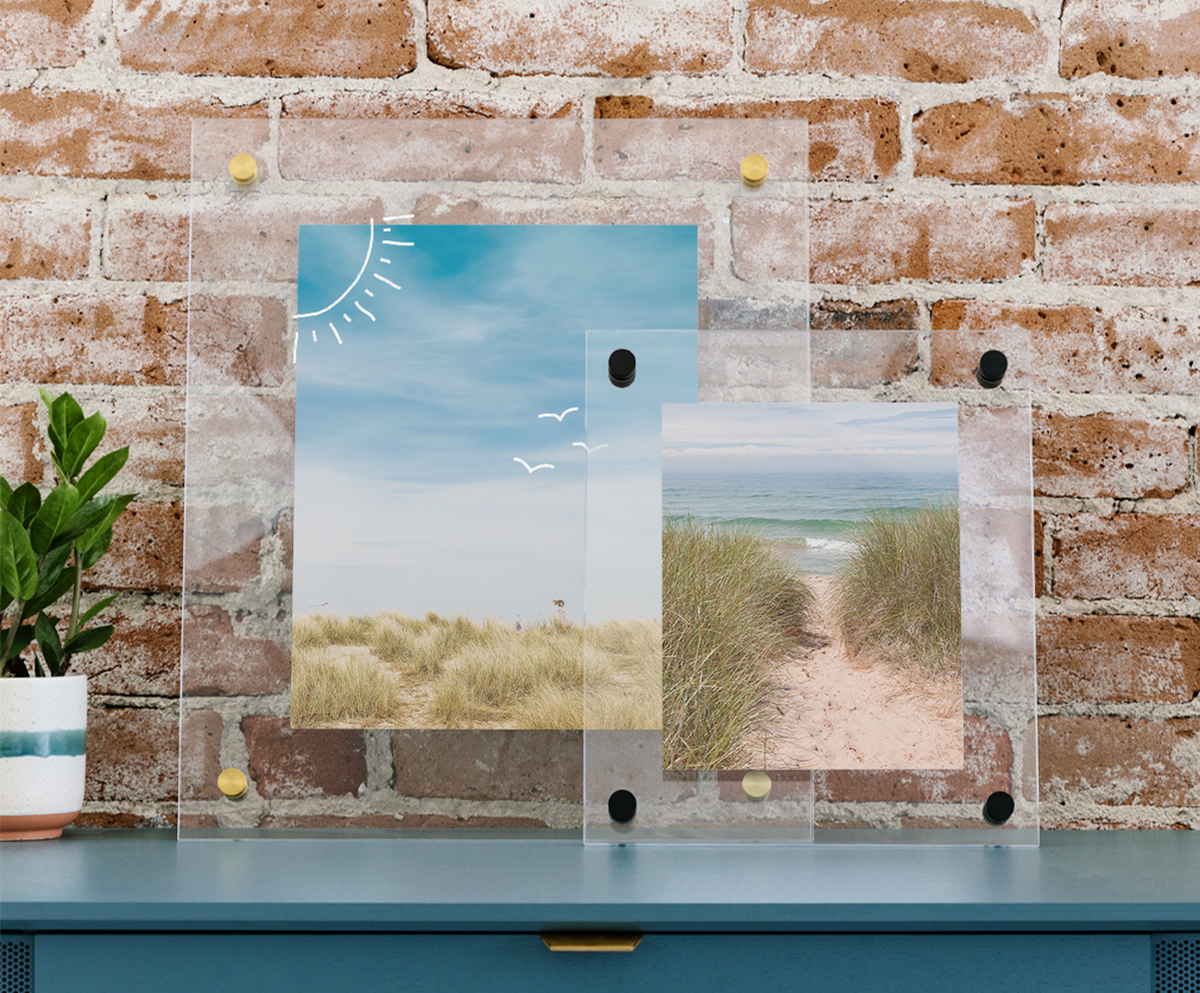 Images in floating frames drawn on in marker by kids