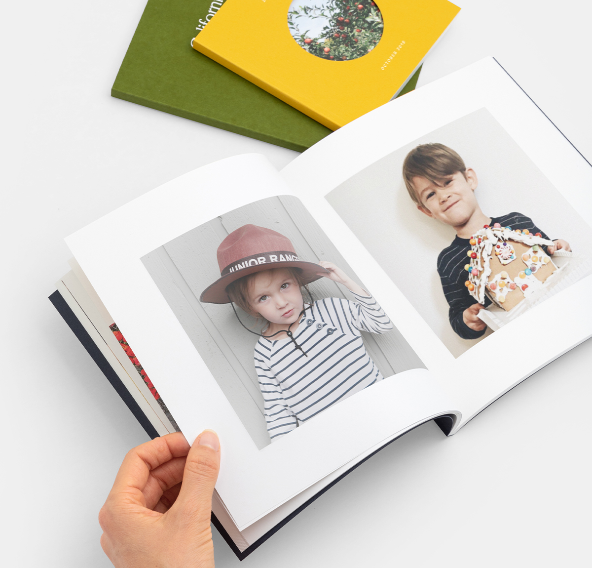 Photo books opened to portraits of two little boys