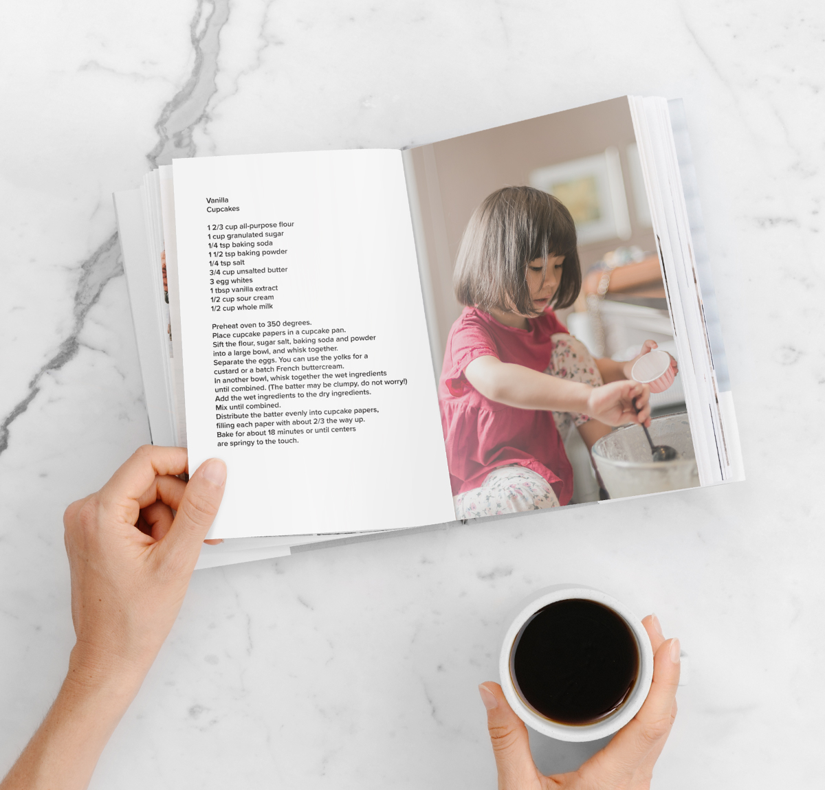 DIY recipe book opened to photo of little girl making cupcakes