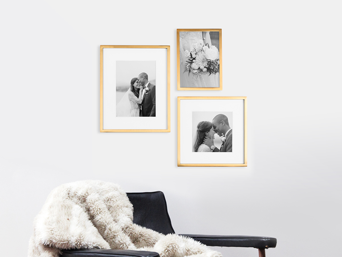Black and white gallery wall with wedding photos