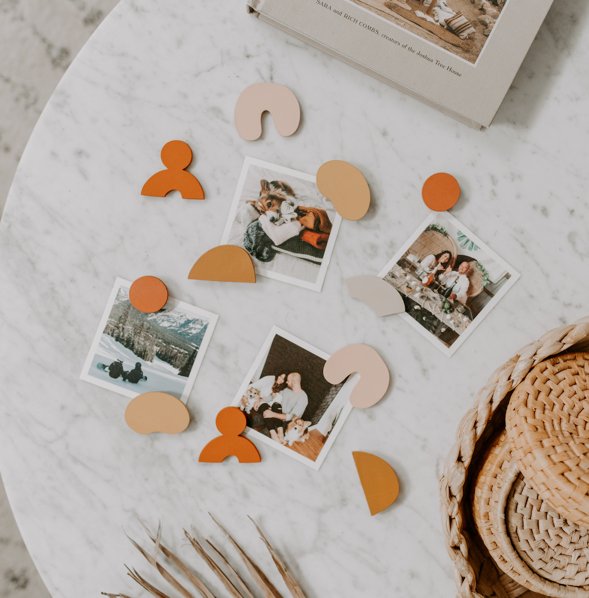 Square prints on table with cute handmade magnets