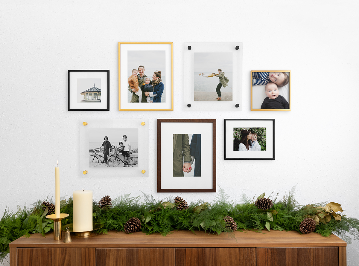 Gallery wall created using assortment of frame styles, sizes, and finishes