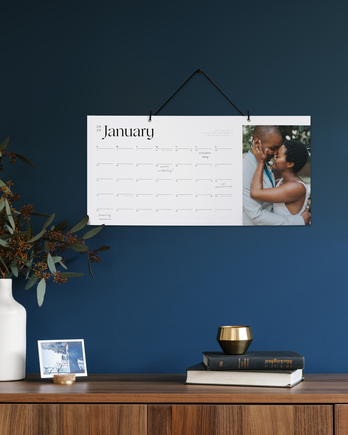 Wall calendar featuring photo of couple embracing on right side