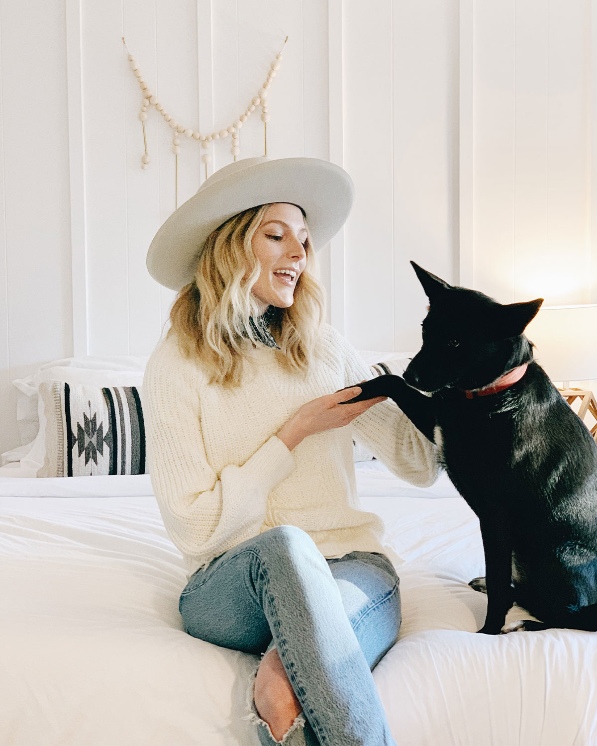 Woman and her dog in a boutique hotel room