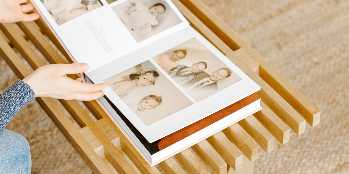 Woman flipping through pages of family history album