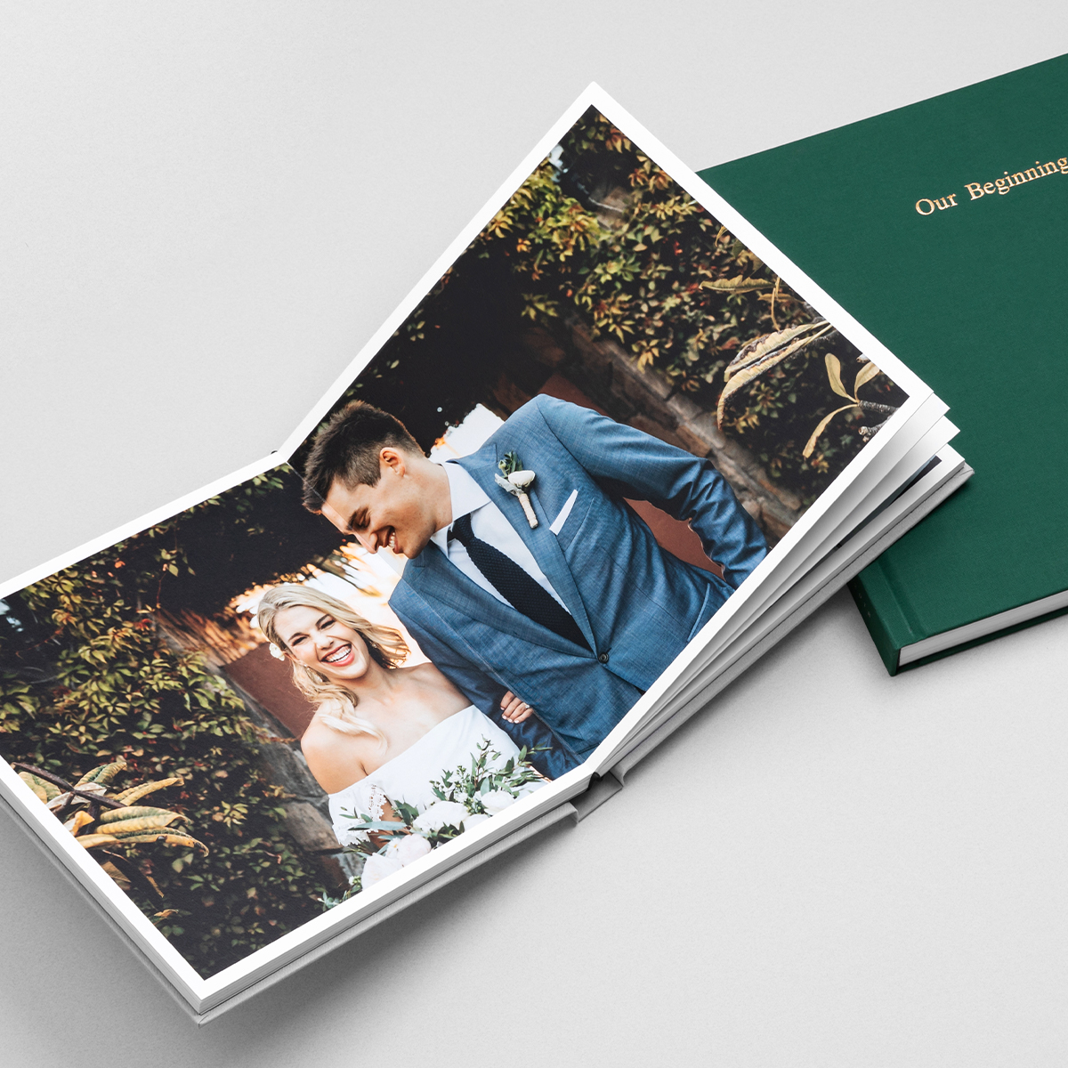 Layflat album opened to two-page photo of bride and groom