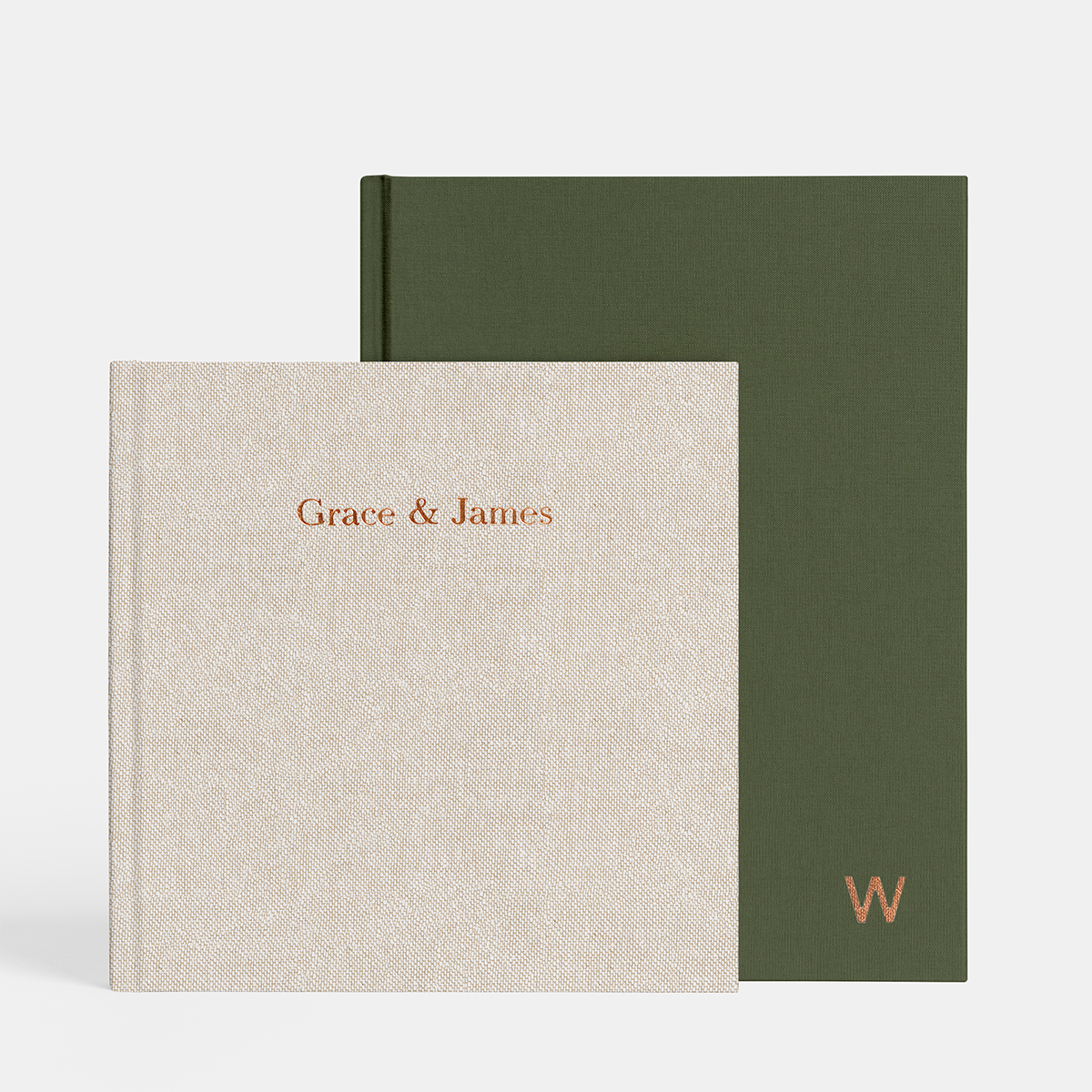 Oatmeal layflat album titled Grace and James stacked in front of olive layflat, both featuring copper foil