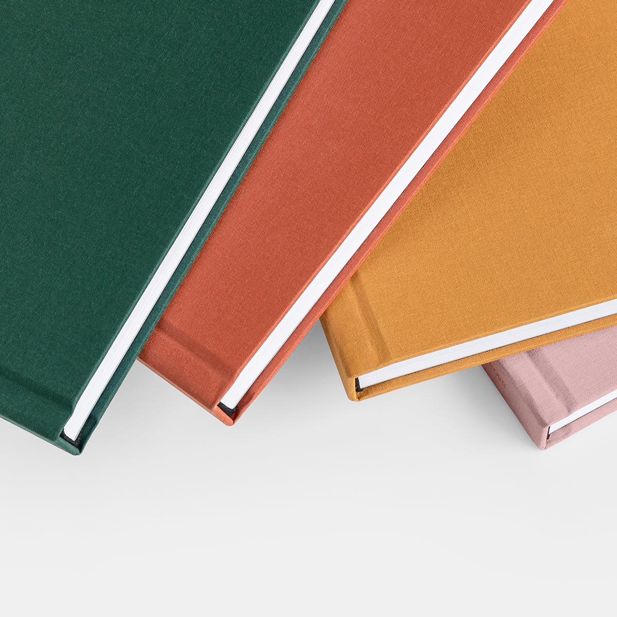 Close up of Layflat photo album's linen cover in four different colors