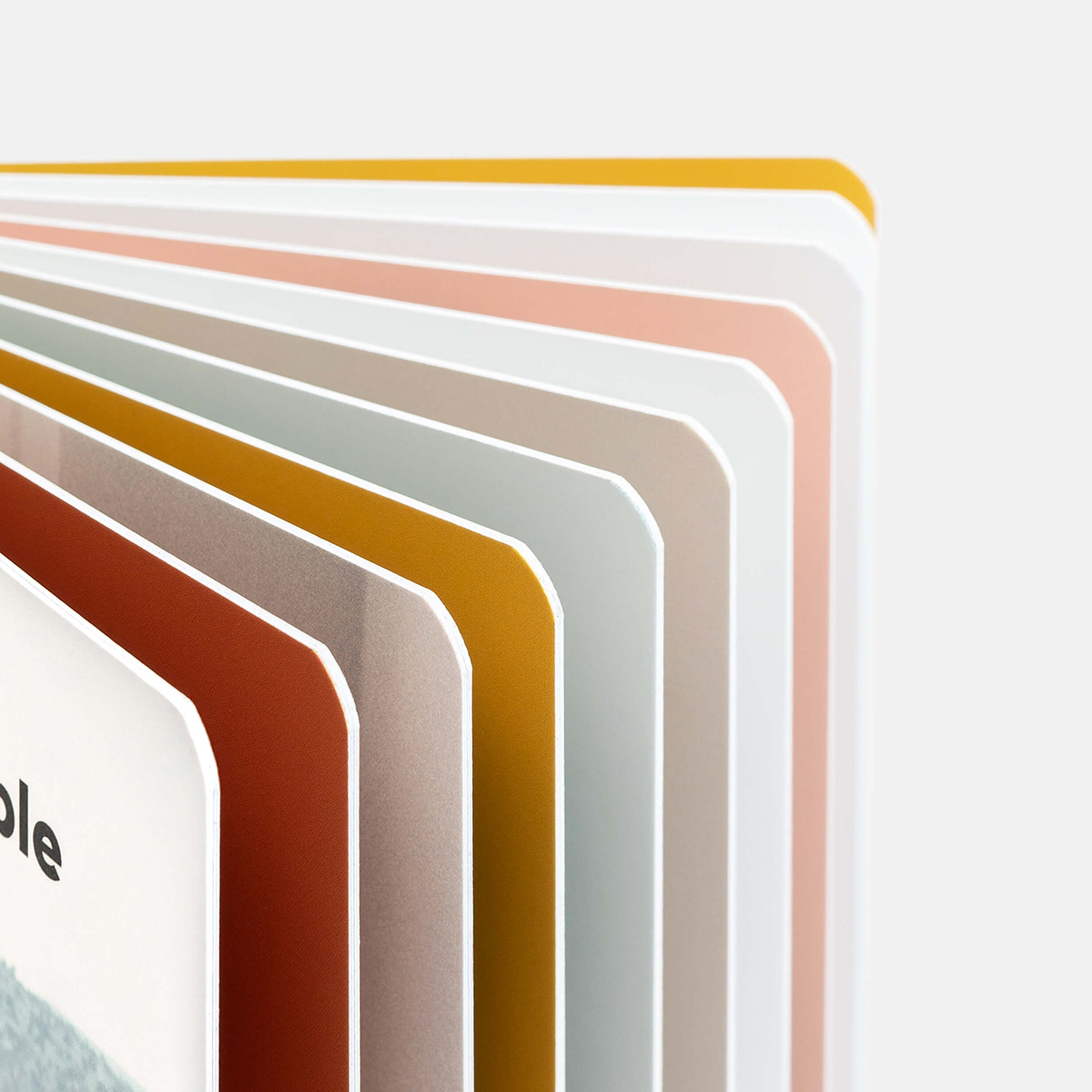 Zoomed in on ultra-thick pages and rounded corners of the Baby Board Book