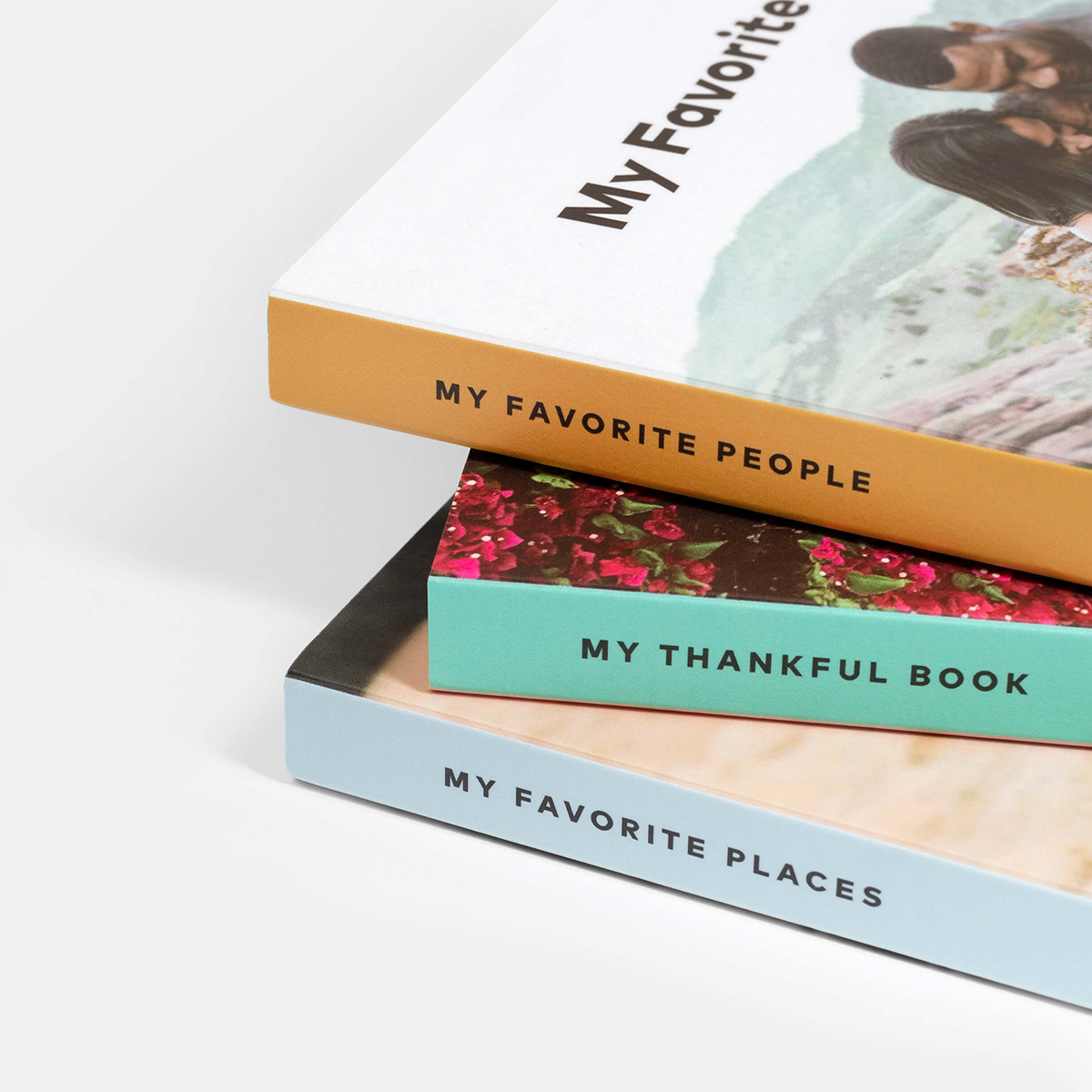Three baby board books with three different themes stacked askew
