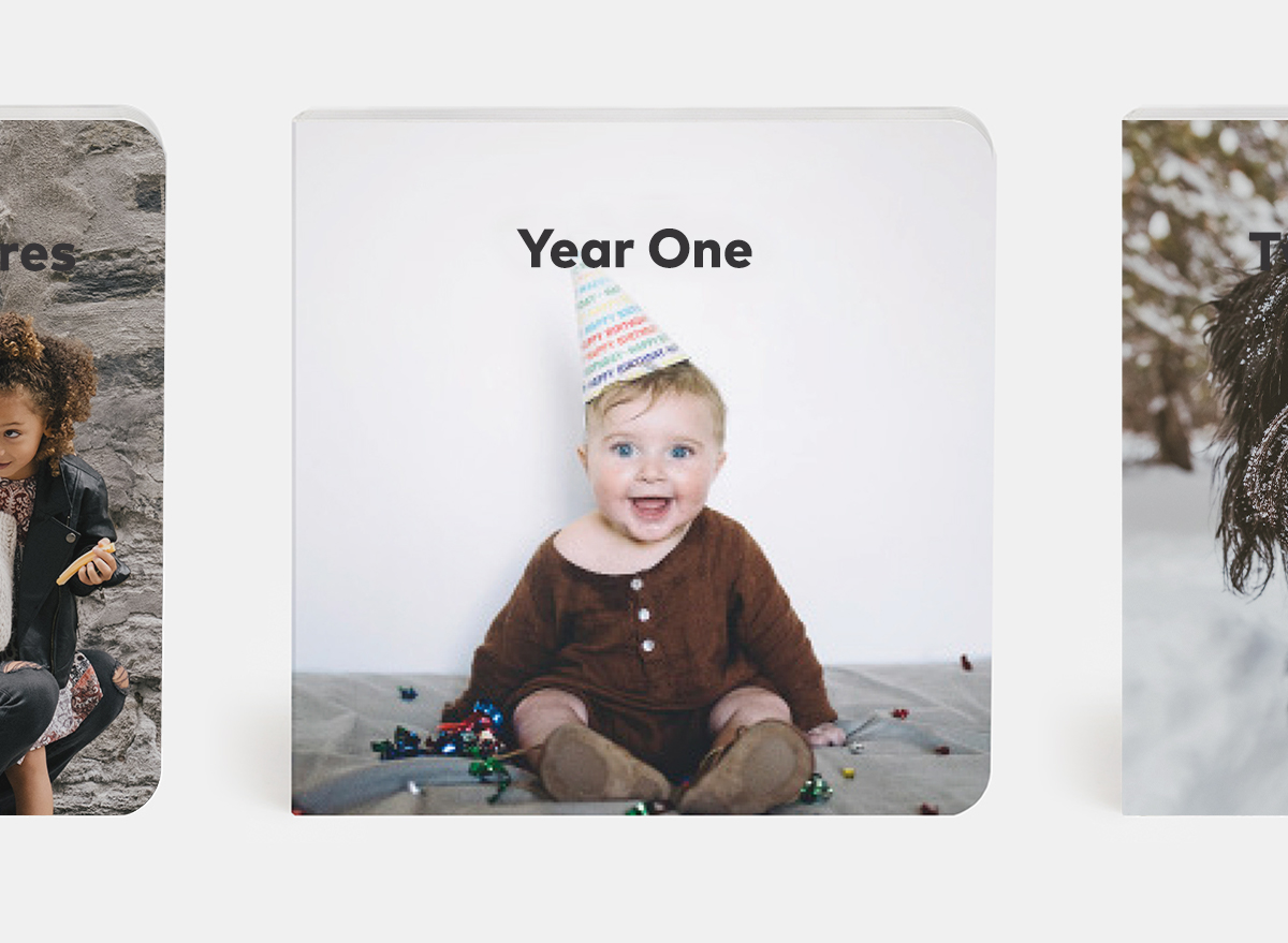 Custom baby board book titled year one featuring baby in birthday hat