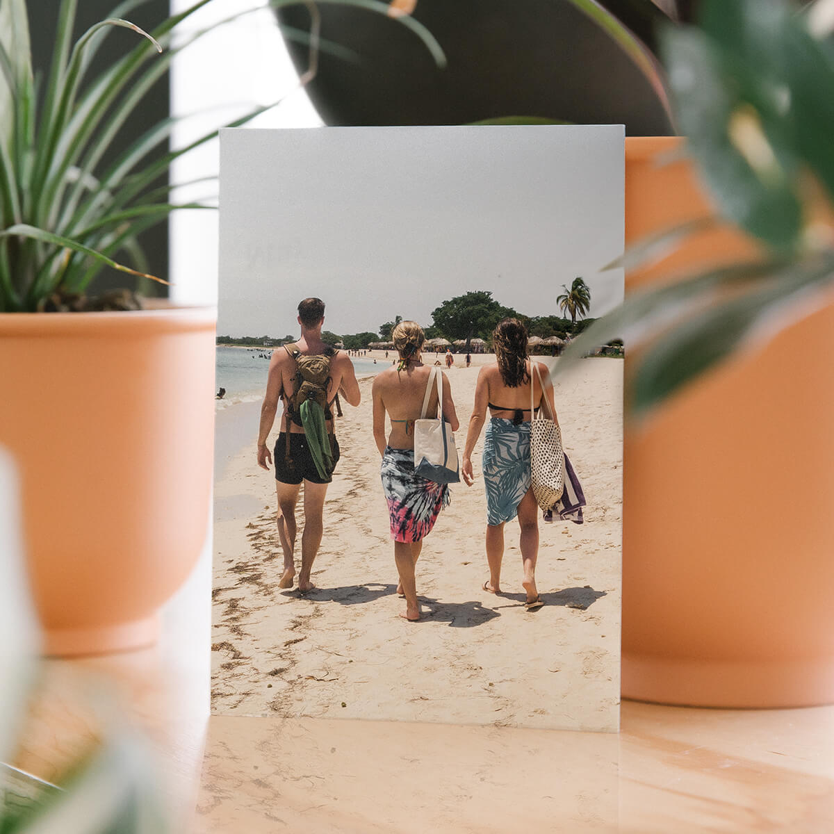 DIY postcard featuring travel photo of friends walking along the beach