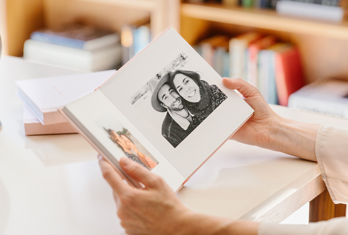 Everyday Photo Book opened to black and white photo of couple on a trip