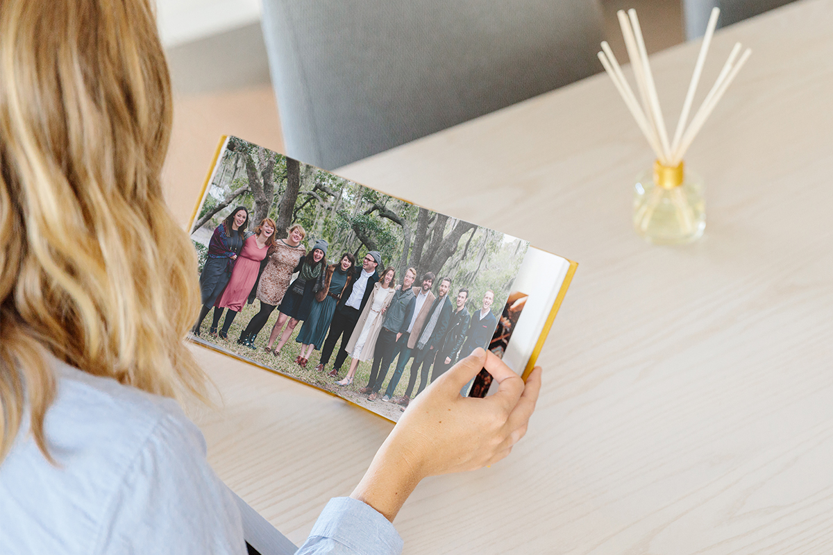 Everyday Photo Book opened to two-page family photo of all the cousins