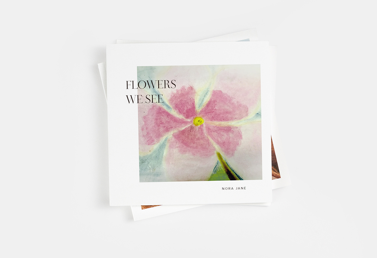 Softcover Photo Book with child's drawing of a flower on the cover
