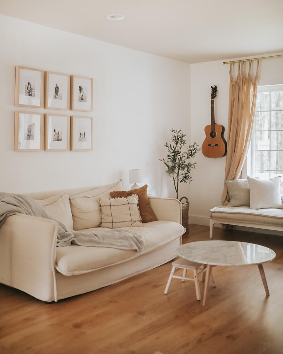 Minimalist living room design with guitar hanging in corner