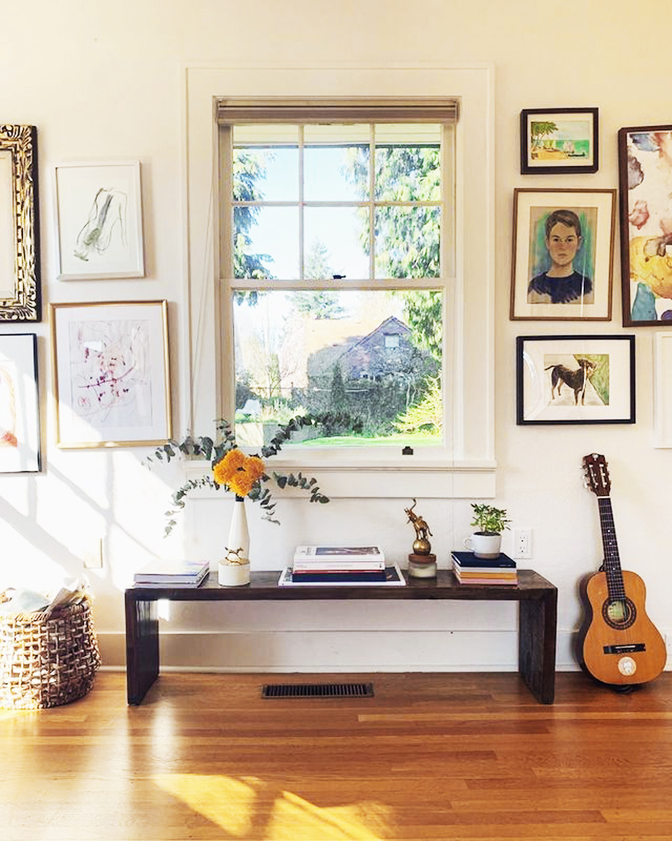 Vibrant gallery wall with large window at the center