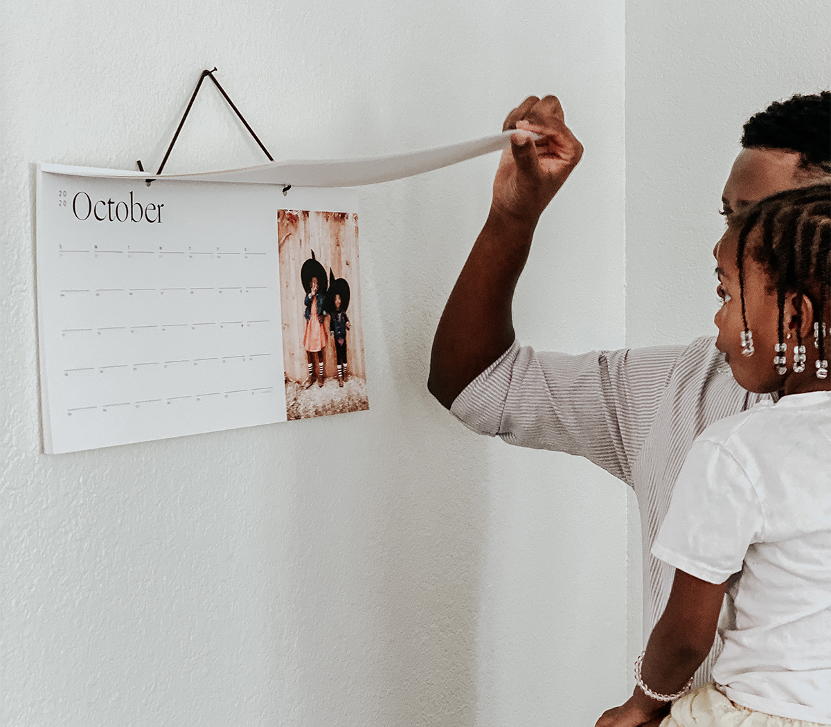 Photo by @mrshazleybaby of father and daughter flipping through Modern Wall Calendar