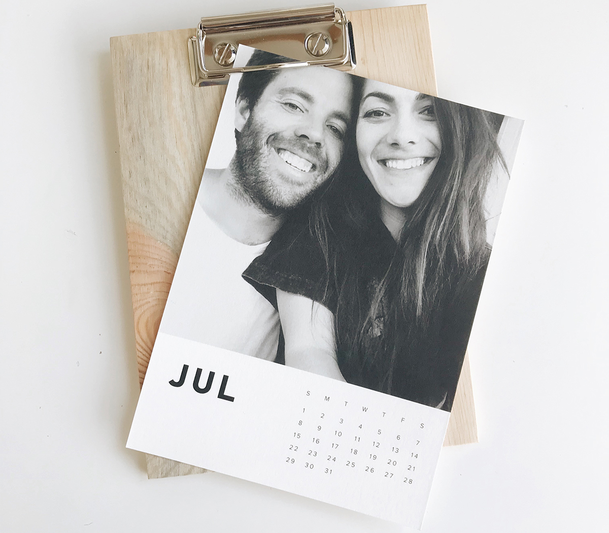 Photo by @relevantraw of Artifact Uprising wood calendar featuring print of couple