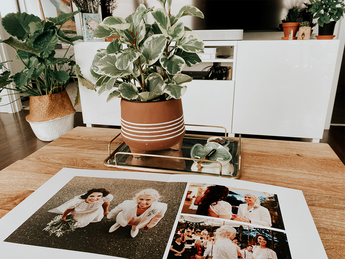 Layflat wedding album open on coffee table