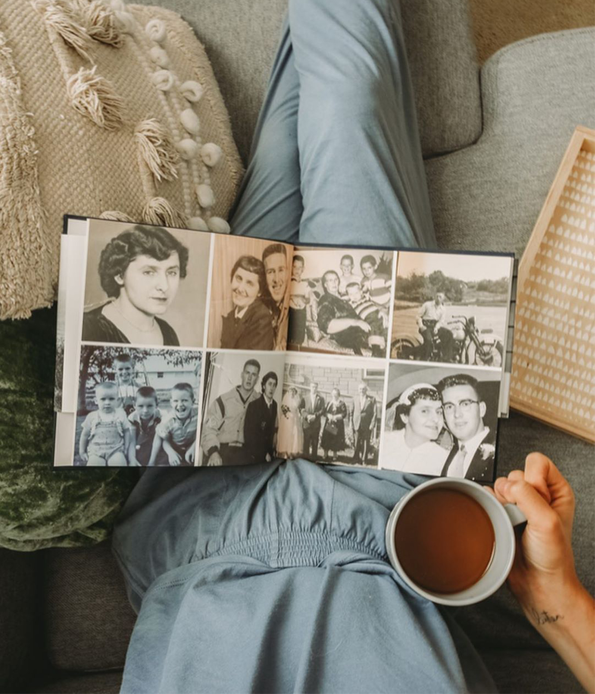 Family history book open on woman's lap