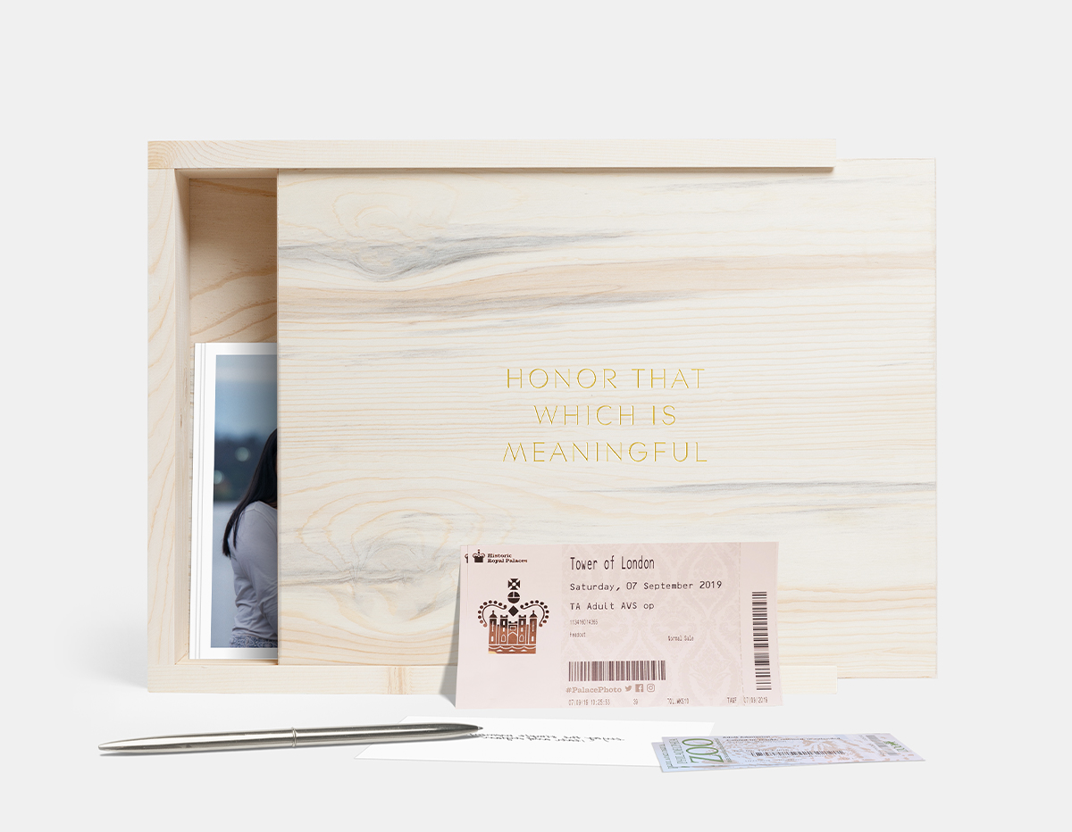 Artifact Uprising Wooden Quote Box with ticket stubs and photo prints inside