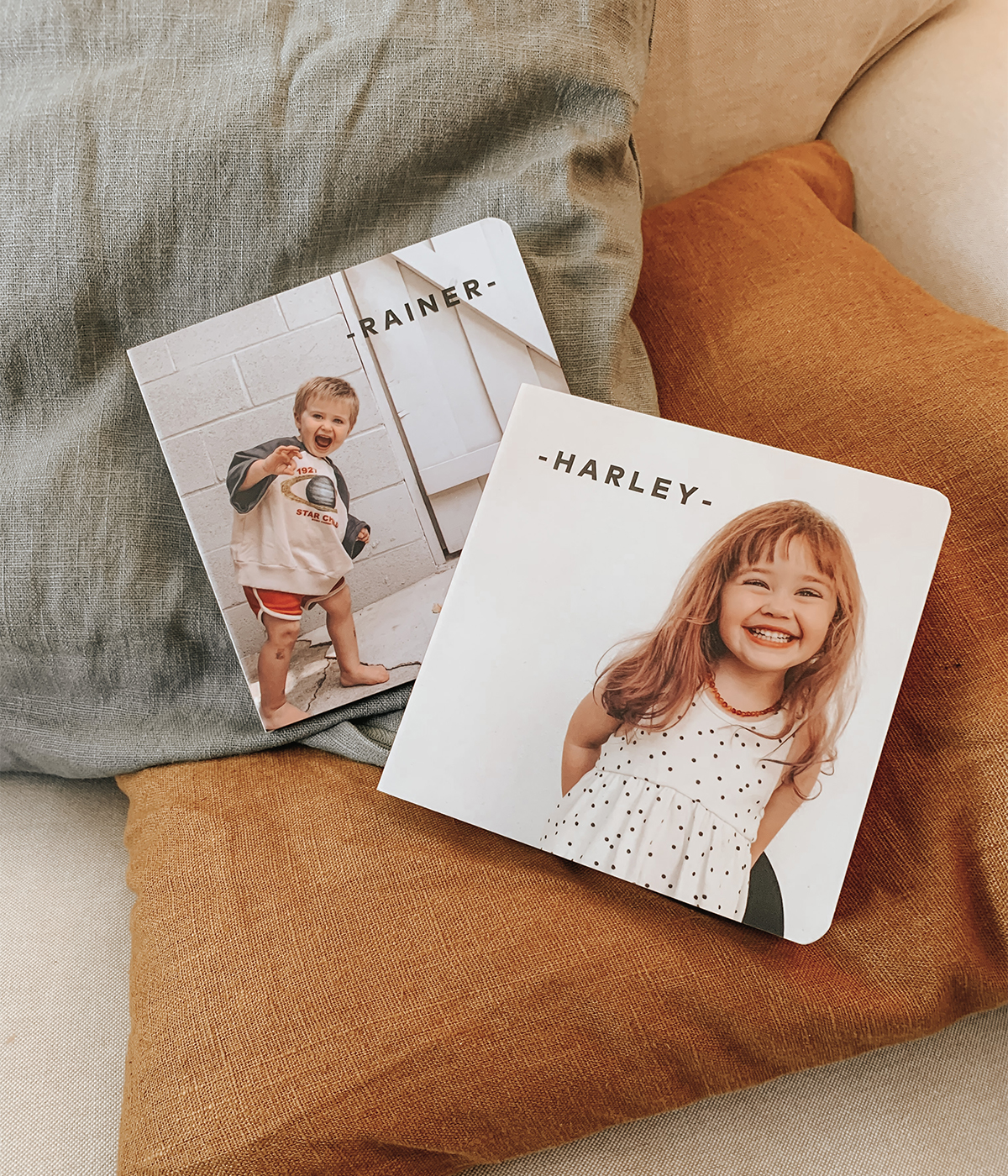 Board books with kids' names and photos on the cover