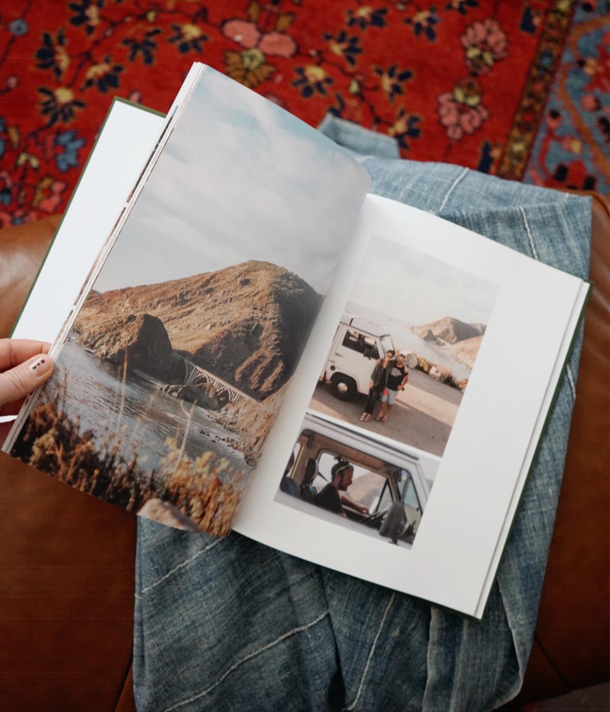 Woman's hand flipping through travel album