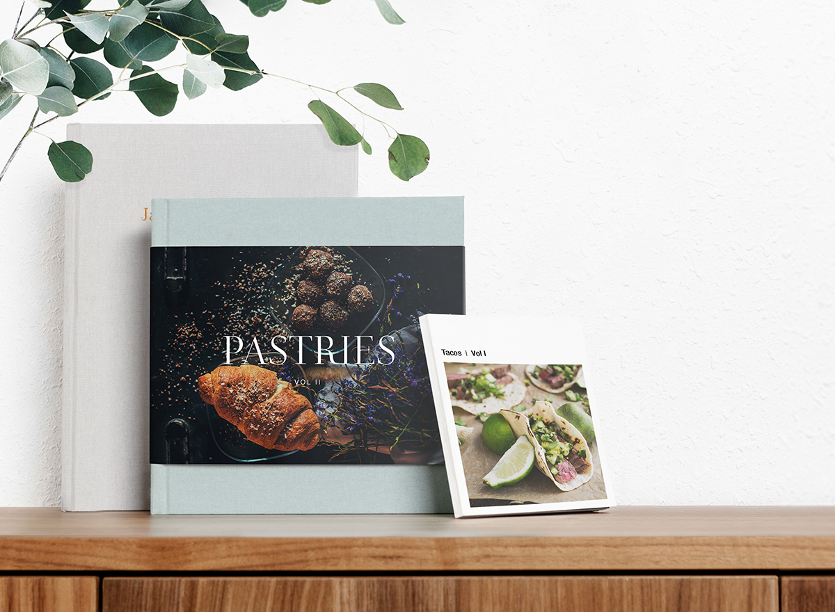 Three different Artifact Uprising photo books printed as cookbooks