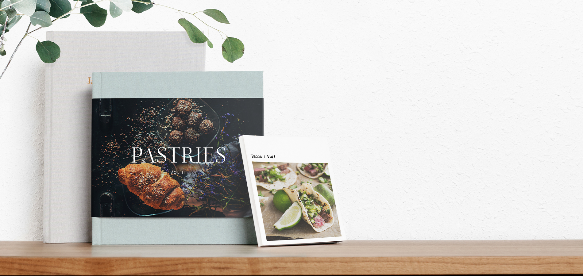 Three different cookbooks created using Artifact Uprising photo books