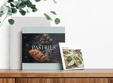 Three different cookbooks printed in three different Artifact Uprising photo books
