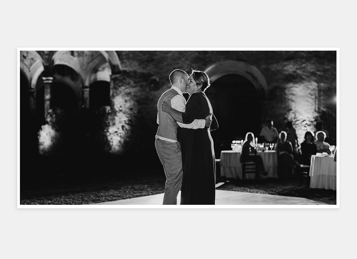 Two-page photo in wedding album of groom dancing with mother