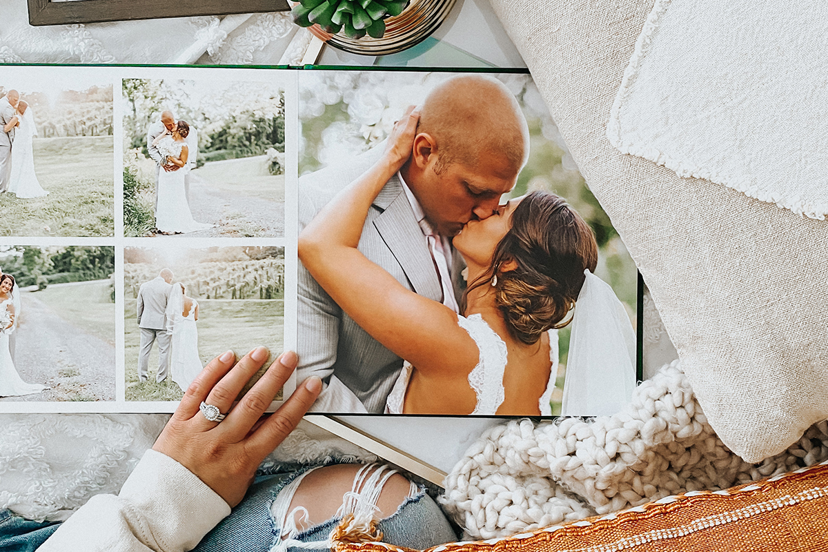 Photo book opened to photos that convey happiness