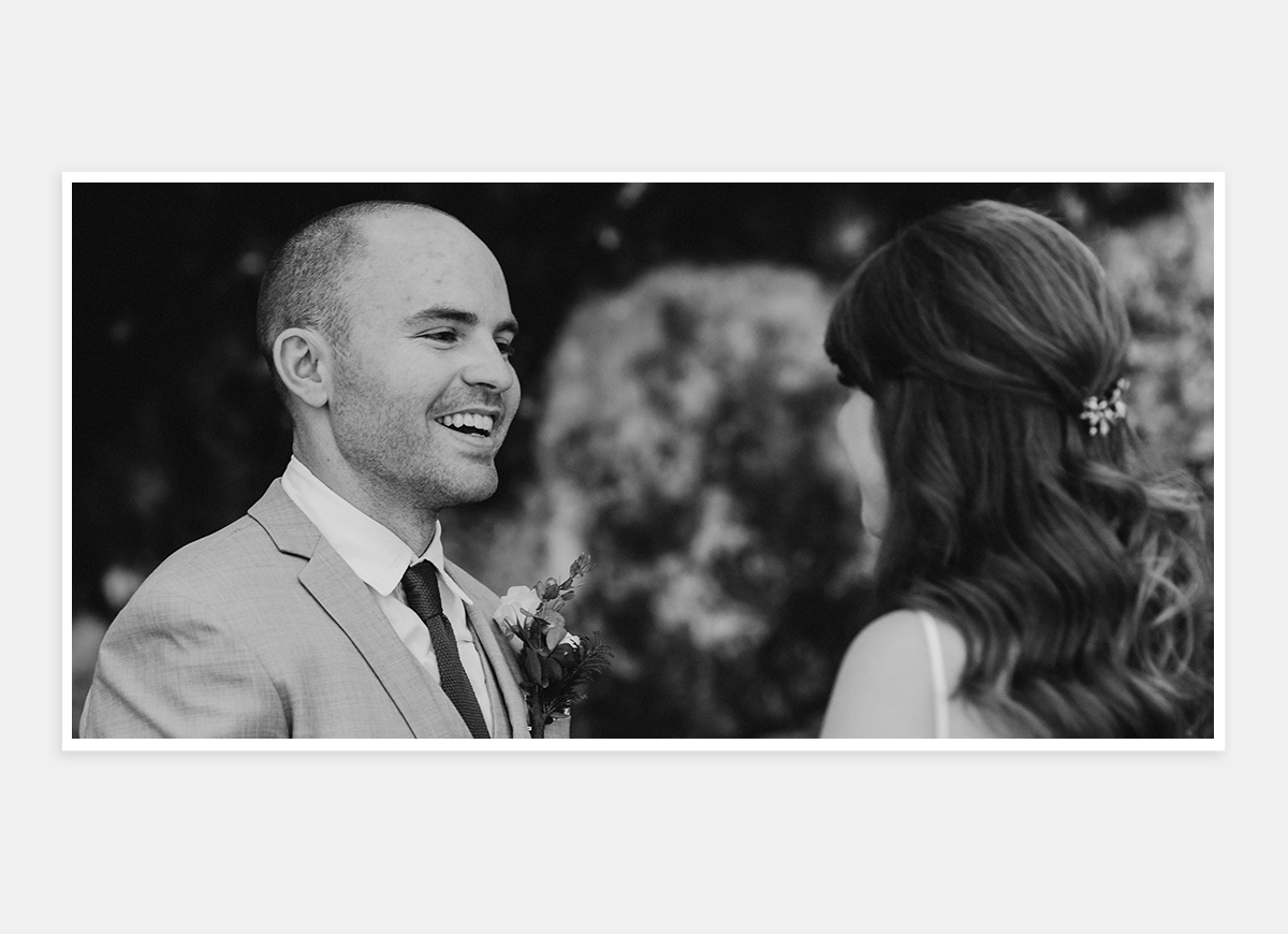Two-page, black and white photo in wedding album of bride and groom looking into each other's eyes